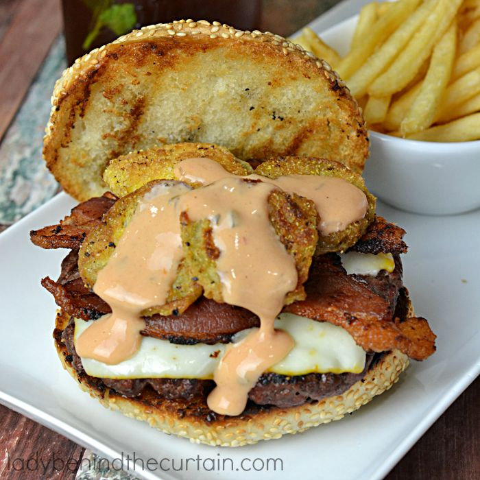 Fried Green Tomato Burgers | A wonderful Southern burger with tangy fried green tomatoes, bacon and a drizzle of thousand island dressing.
