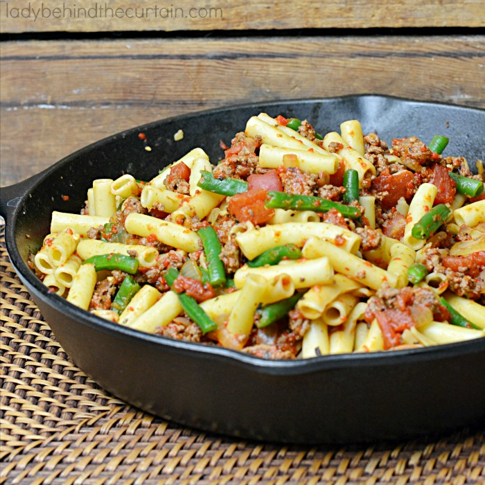 Light Red Pepper and Beef Pasta | A hearty meal with a different kind of red sauce using roasted red peppers and chopped tomatoes together.