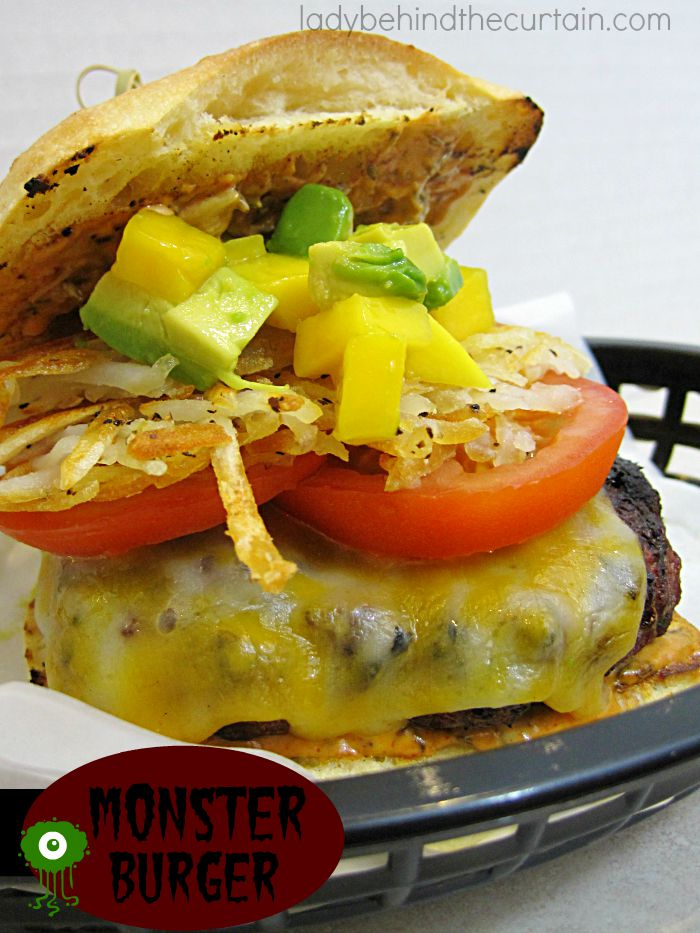 This Monster Burger is piled high with fresh sliced tomatoes, a mango and avocado topping plus a hash brown patty!