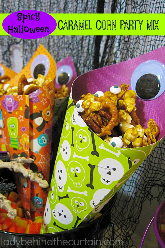 Spicy Halloween Caramel Corn Party Mix | The spicy sweet caramel corn party mix has the perfect balance with the addition of pumpkin spice and red pepper.