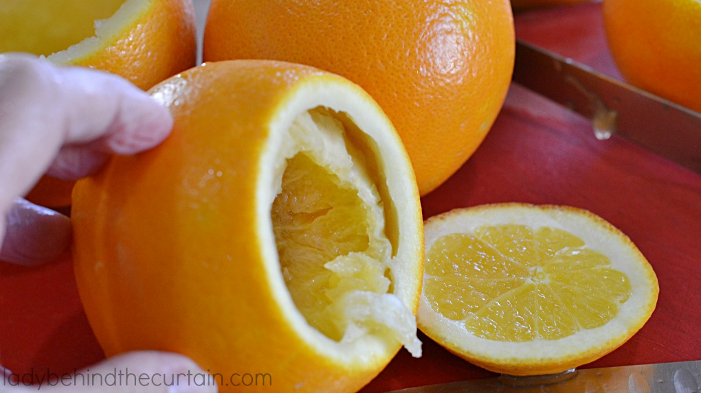 Holiday Citrus Votive Holders   Add the fresh scent of citrus to your holiday table, buffet or bathroom with this inexpensive easy to make votive holders.