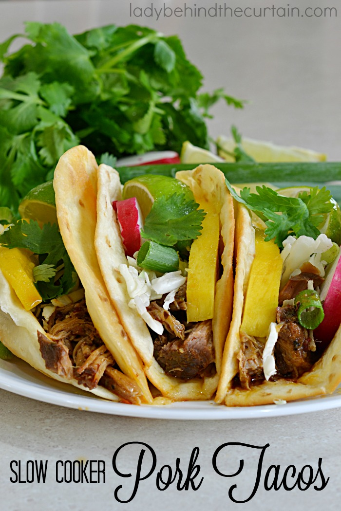 Slow Cooker Pork Tacos | The perfect Taco night recipe to feed a crowd! Serve these tacos Island (baja) style!