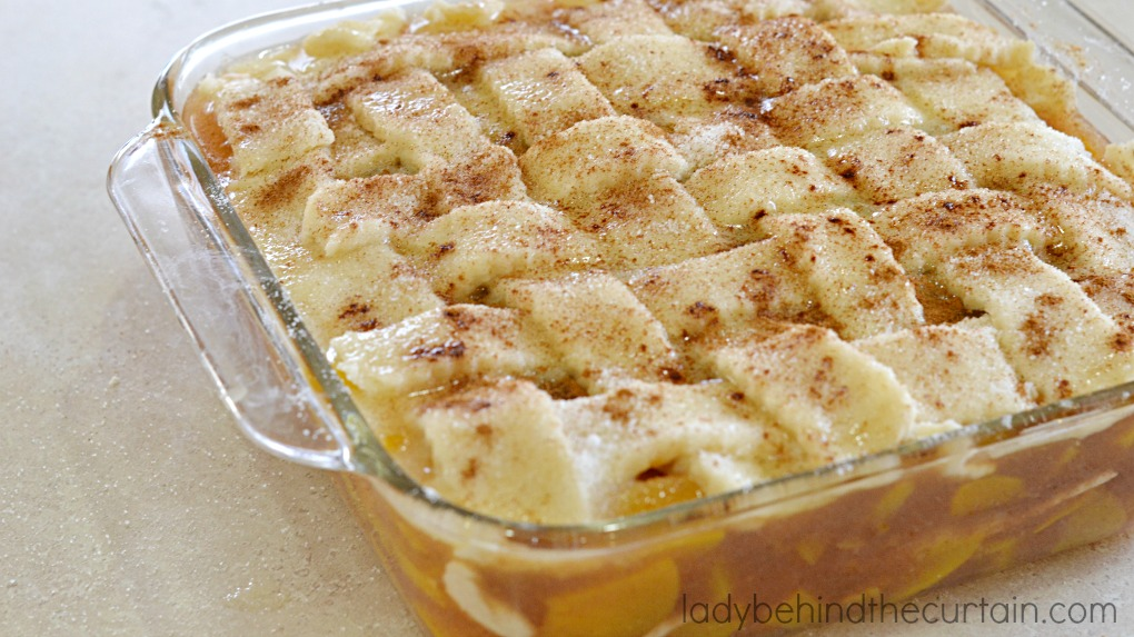 Simply the best family gathering dessert.  Full of peaches with tender pie dough dumplings and a crunchy cinnamon toast topping.