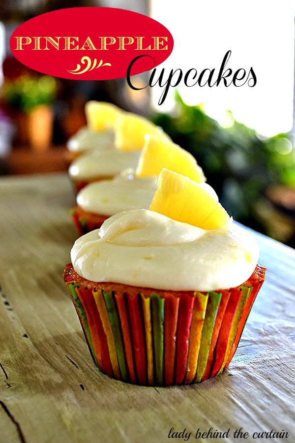 Lady-Behind-The-Curtain-Pineapple-Cupcakes