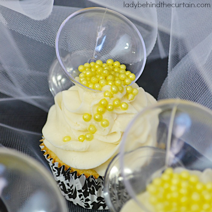 Champagne Cupcakes | These fluffy cupcakes have just a hint of champagne and are topped with a delicious creamy frosting.