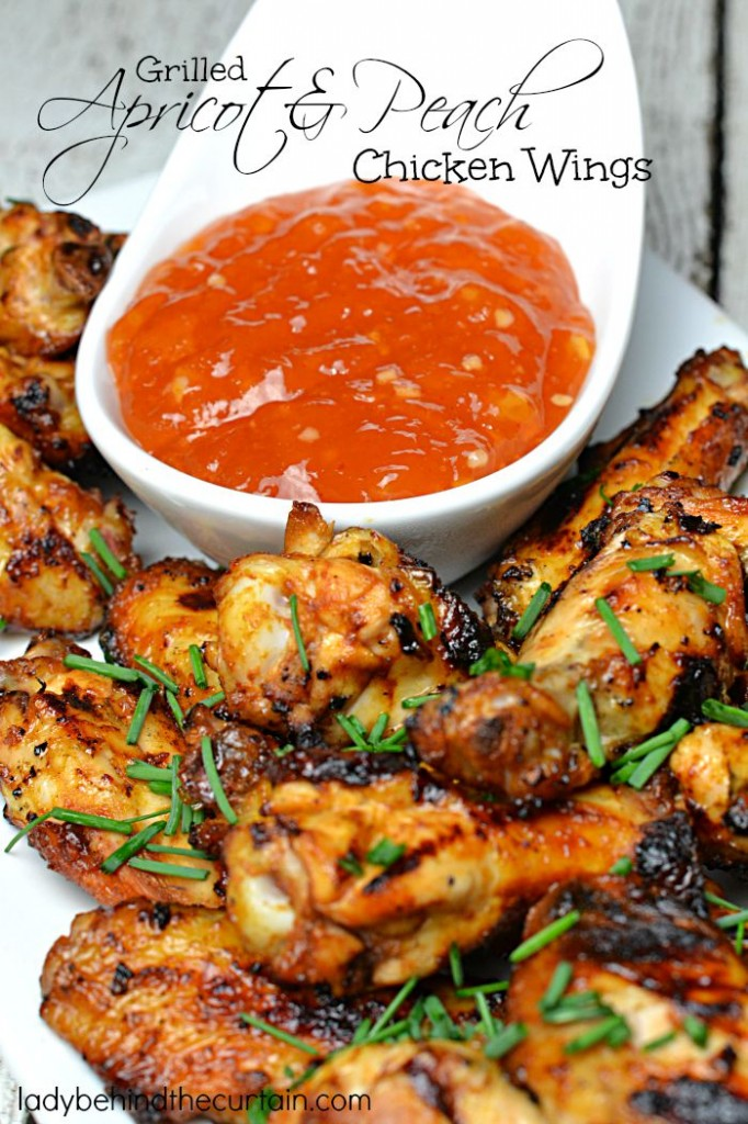 Grilled Apricot and Peach Chicken Wings | These grilled chicken wings are drenched in a sweet saucy mixture of fresh peaches with a delicious dipping sauce made from apricot jam.