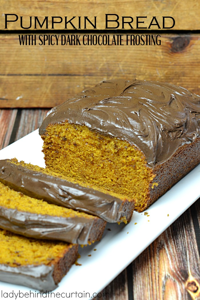 Pumpkin Bread with Spicy Dark Chocolate Frosting | This addictive bread is like eating a delicious frosting pumpkin donut!