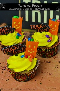Banana Pecan Trick or Treat Halloween Cupcakes | A wonderfully dense banana bread like cupcake topped with a delicious cream cheese frosting.