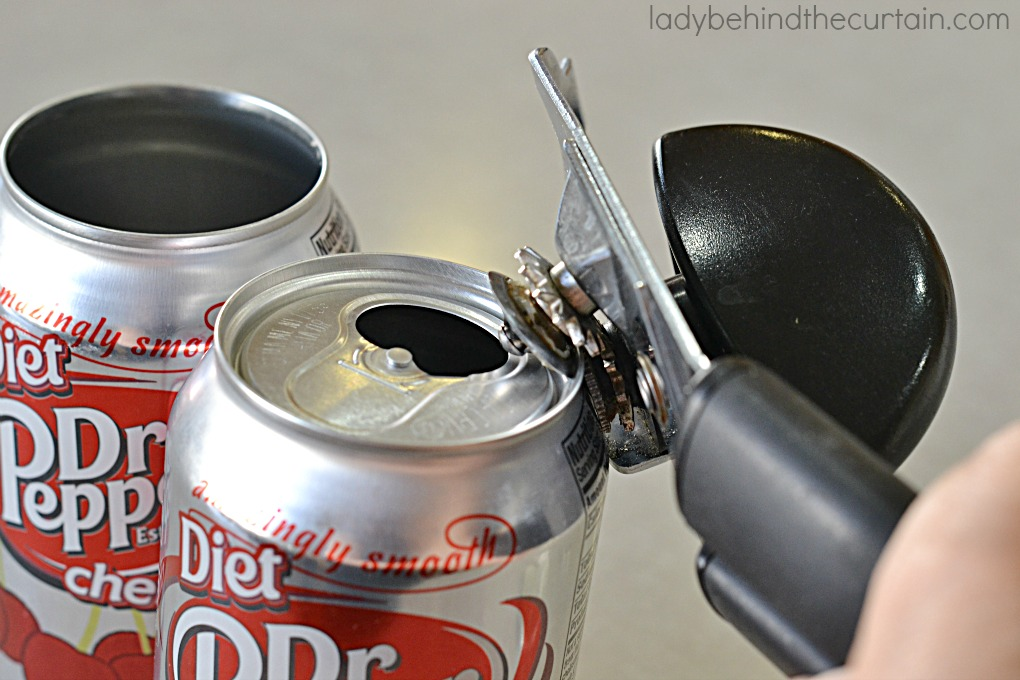 DIY Soda Can Drinking Cups   This is a fun way to upcycle your used soda cans. Perfect for game day or a fun party.