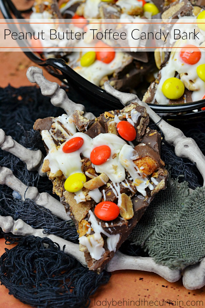 Peanut Butter Toffee Candy Bark | Layers of chopped Butterfinger bars, Heath bars, peanut butter cups, M&M's and peanuts all embedded in chocolate!