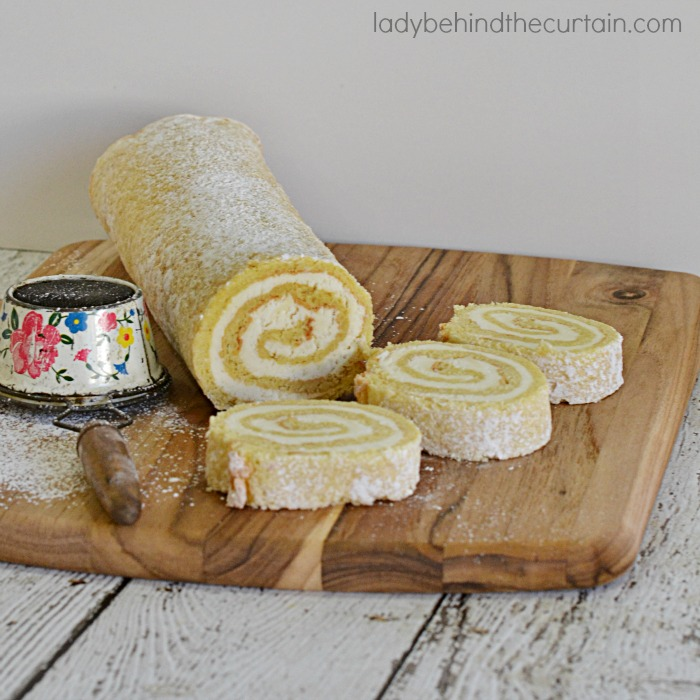 Lemon Créme Cake Roll | A light and fluffy sponge cake with a delicious easy to make lemon créme filling.