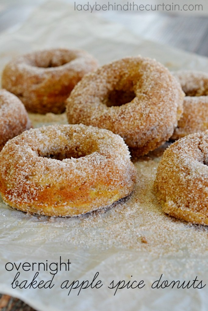 Overnight Baked Apple Spice Donuts | A tender donut with shredded apple and apple pie spice, rolled in a sugar and cinnamon mixture.