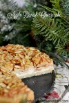 Apple Danish Cheesecake   This cheesecake starts with a delightful almond crust a thin layer of cheesecake all topped with tart apple rolled in a brown sugar cinnamon mixture and almonds.