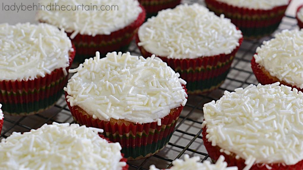 Cranberry Bliss Cupcakes | Everything you love about Cranberry Bliss Bars in a cupcake! Chunks of white chocolate, cranberries, pieces of crystallized ginger all topped with a to die for chocolate frosting.