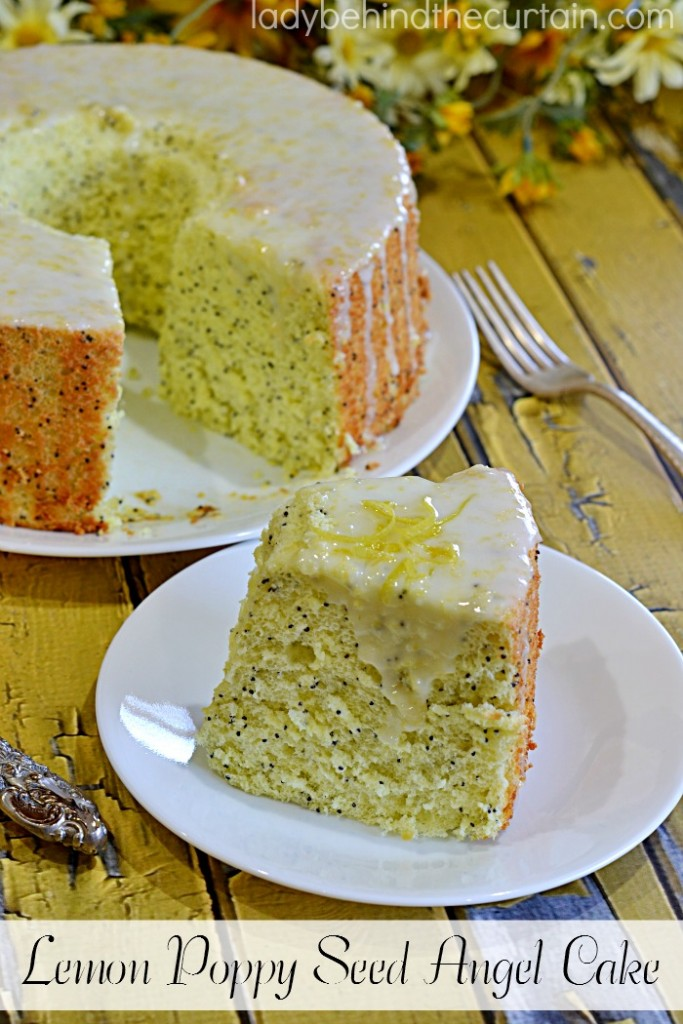 Lemon Poppy Seed Angel Cake | A light airy cake full of lemon flavor with lots of poppy seeds. The perfect dessert after a heavy meal.