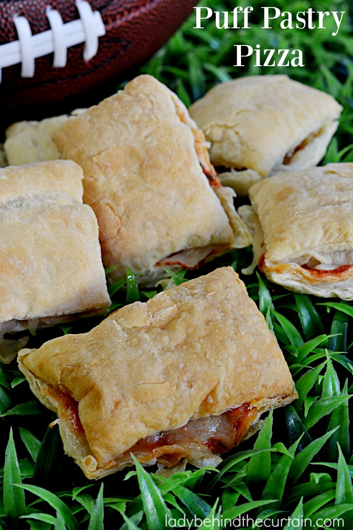 Puff Pastry Pizza   Light, crispy and full of flavor that's how I would describe these little pillows of cheesy goodness. Perfect as a Game Day or after school snack.