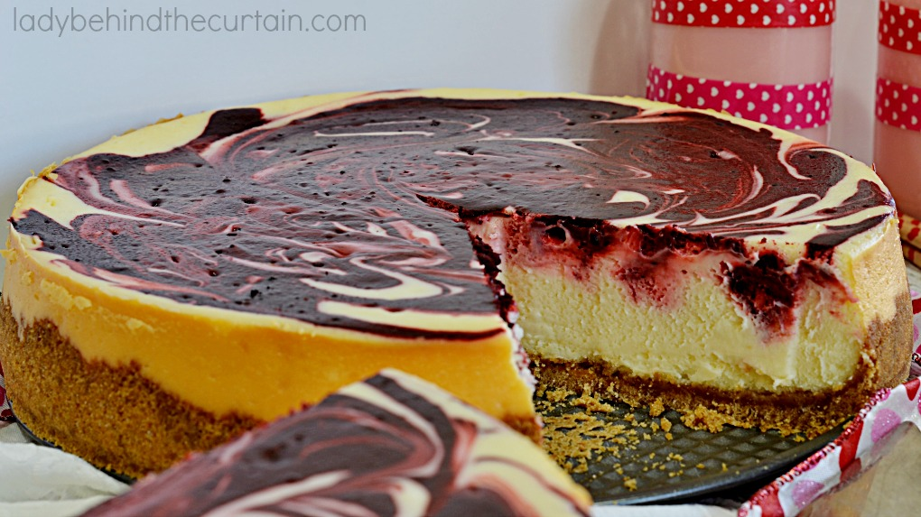 Red Velvet Swirl Cheesecake | A delightful mixture of the timeless red velvet favorite paired with a silky cheesecake.  Simply the perfect Valentine's Day Dessert!