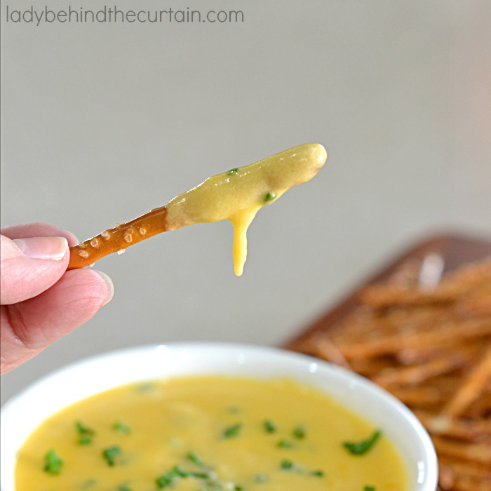 This Easy Beer Cheese Sauce is the Bomb! Perfect for dipping, drizzling over vegetables and sandwiches.