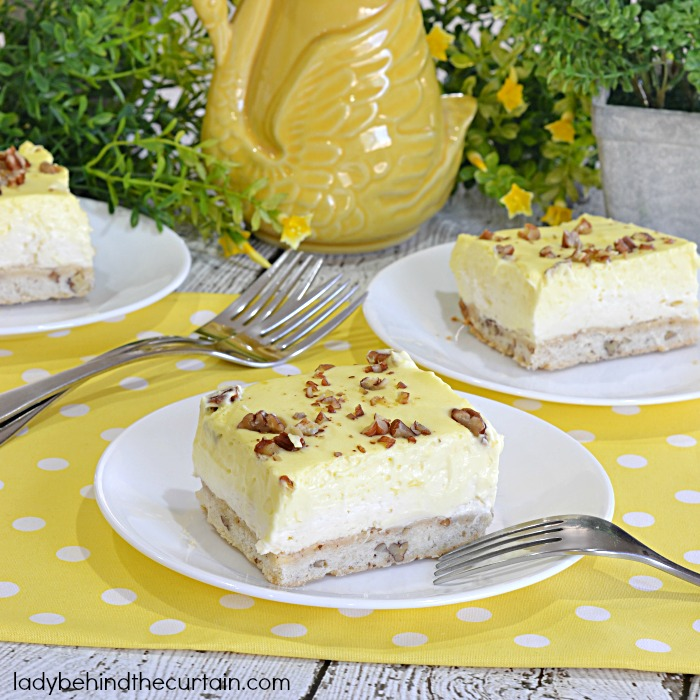 Lemon Triple Layer Bars | You'll have your guests Ooooing and Awwwwing when you bring some sunshine to your table with these easy to make light and fluffy bars!