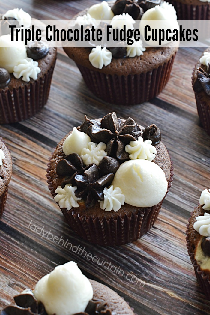 Triple Chocolate Fudge Cupcakes   Not only rich and decadent but also filled with a creamy center!
