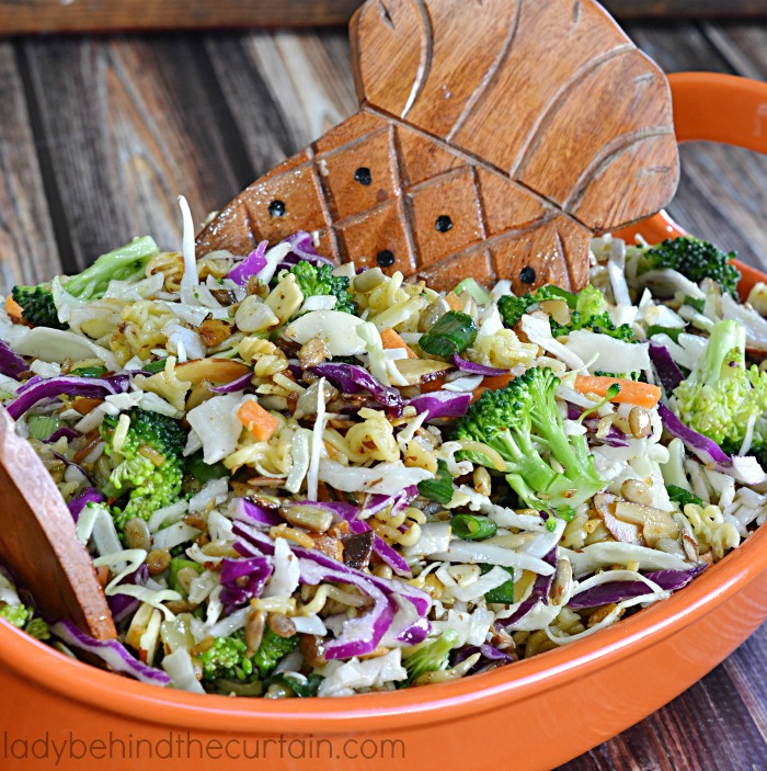 Mad Hatter Salad |When bringing the same old coleslaw just isn't enough. This salad coleslaw is simply the best! Full of fresh vegetables with sautéed nuts and top ramen noodles. Deliciously covered with a sweet dressing. Great for family, church or barbecue gatherings.