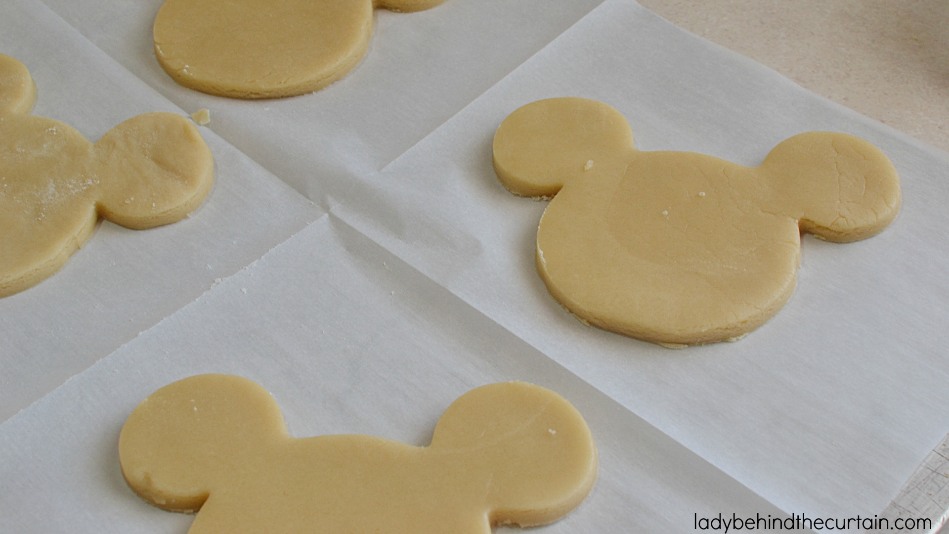 Copycat Disneyland Mickey Mouse Sugar Cookies | These giant cookies have a delicious butter flavor with just the right amount of softness and dipped in melted candy.