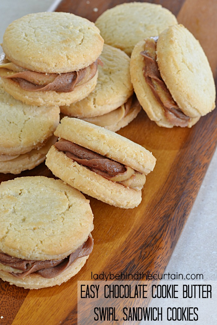 Easy Chocolate Cookie Butter Swirl Sandwich Cookies | These easy to make cookies start with a store bought cookie and are transformed into party cookies!
