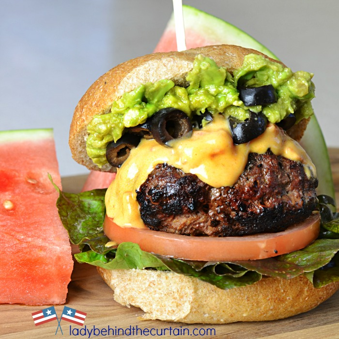 Firecracker Burgers | This tasty burger has a little surprise inside. This burger is the perfect bar food. With two of your favorites in one!