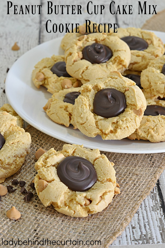Peanut Butter Cup Cake Mix Cookie Recipe | If you are a fan of peanut butter cups or if you know someone who is.....then this is the cookie for you! The perfect chewy cookie! With a rich peanut butter cookie and a dark chocolate center to cut the richness.