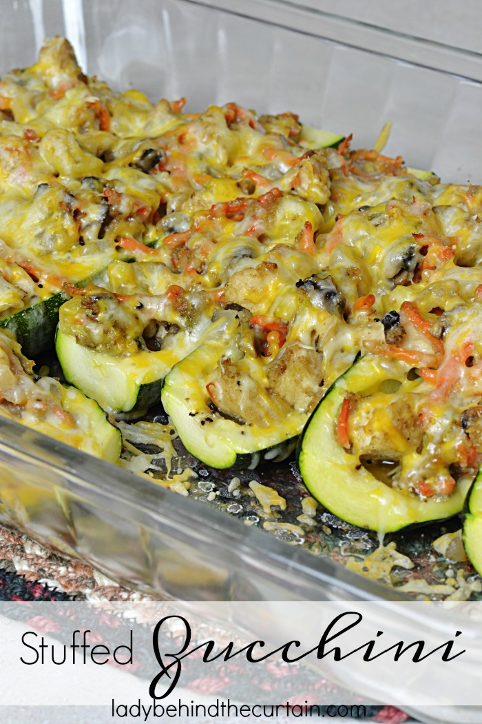 Stuffed Zucchini | Hollowed out zucchini filled with chicken, mushrooms, carrots and more great ingredients to make this the best light summer dish!