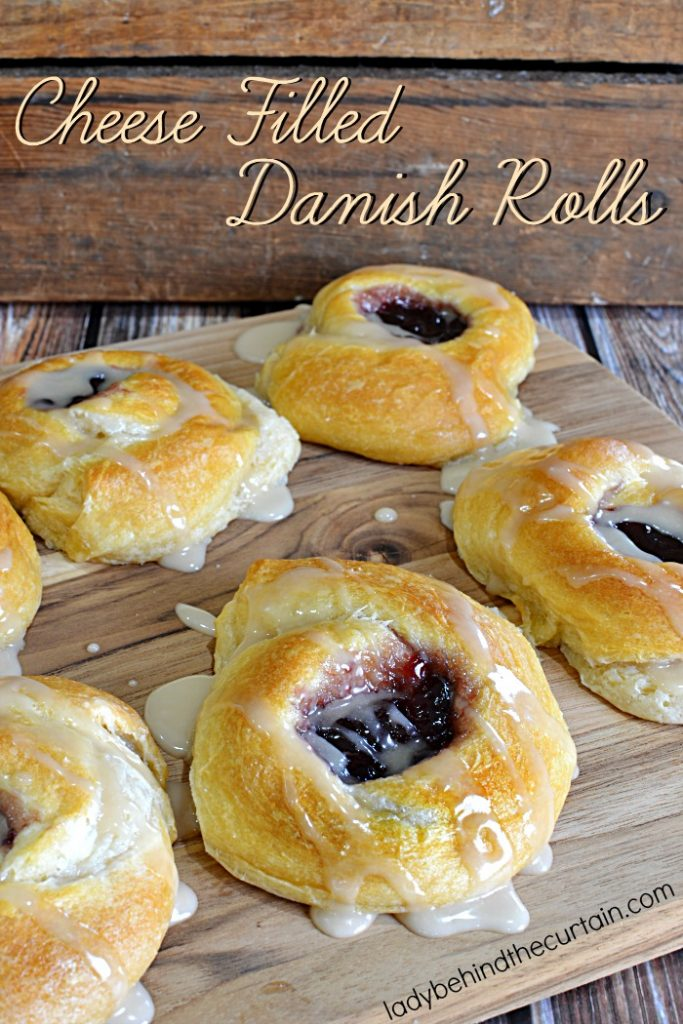 Cheese Filled Danish Rolls | Start with store bought crescent rolls, with cheesecake filling and a dollop of jelly. These giant rolls are everything you love about danish rolls.