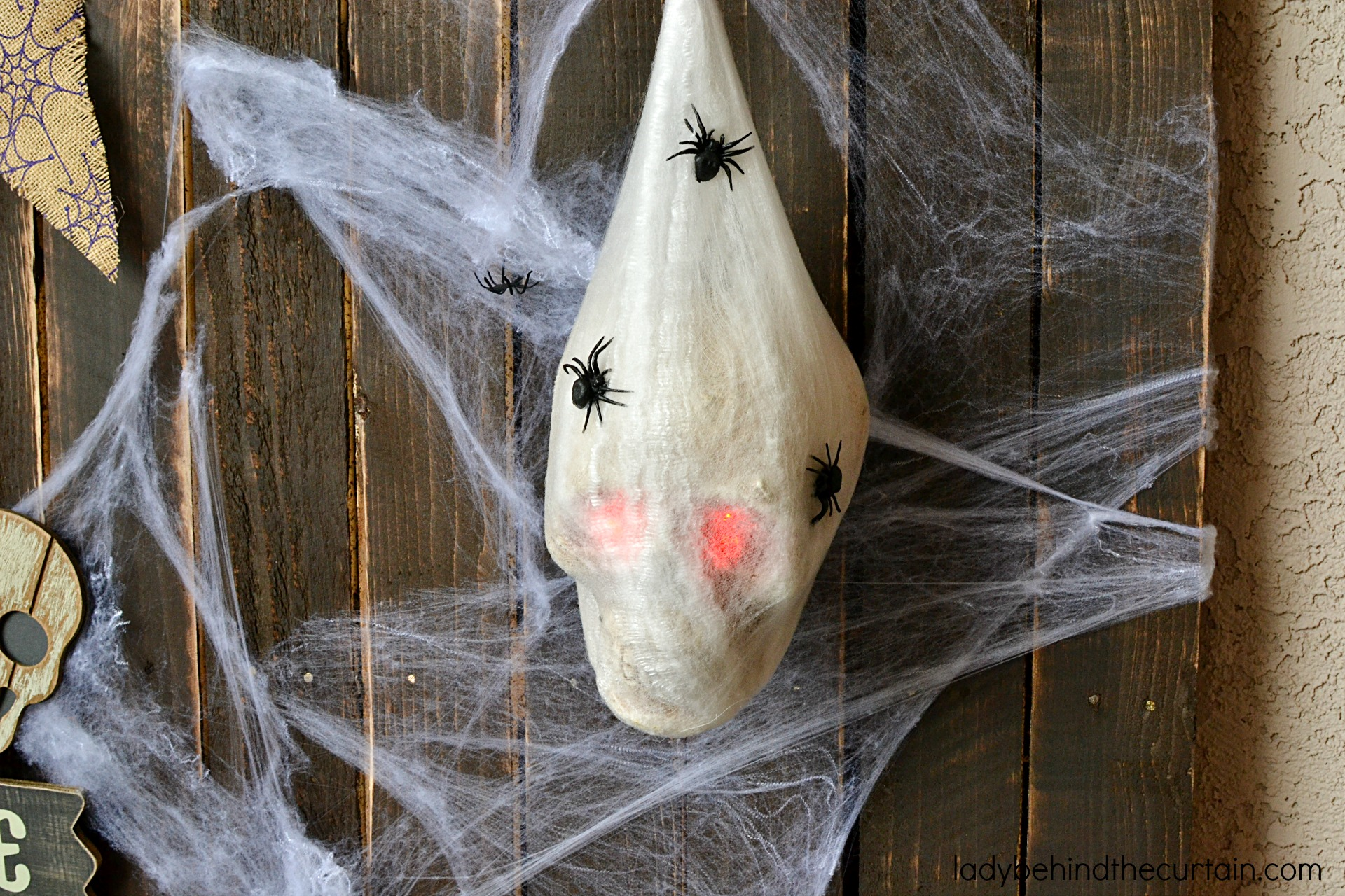 Halloween Front Porch Decorating Ideas | The theme for this creepy Halloween Front Porch is bones and spiders! It may be creepy but it's not scary. I chose to use bones and spiders as my focus because they are so easy to find and inexpensive too!