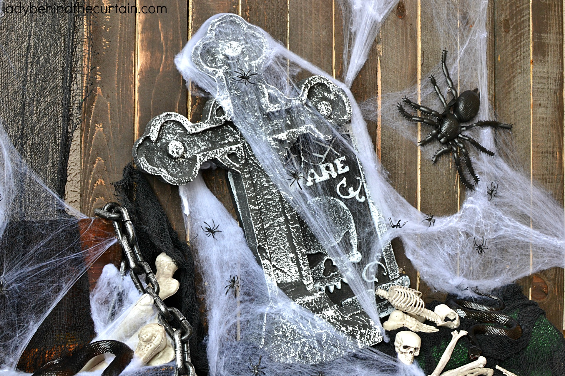 Halloween Front Porch Decorating Ideas   The theme for this creepy Halloween Front Porch is bones and spiders! It may be creepy but it's not scary. I chose to use bones and spiders as my focus because they are so easy to find and inexpensive too!