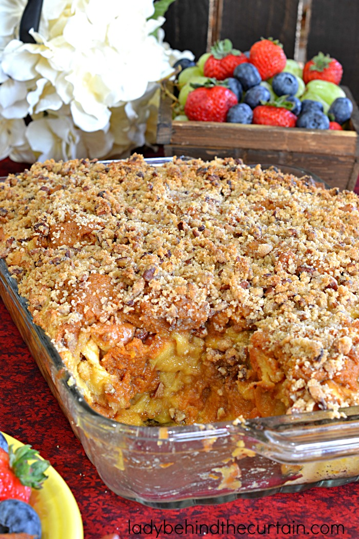 Pumpkin Pecan Bread Pudding Recipe | This semi homemade bread pudding is the best! With layers of cream soaked Challah bread, dollops of pumpkin pie and a pecan streusel on top that is to die for.