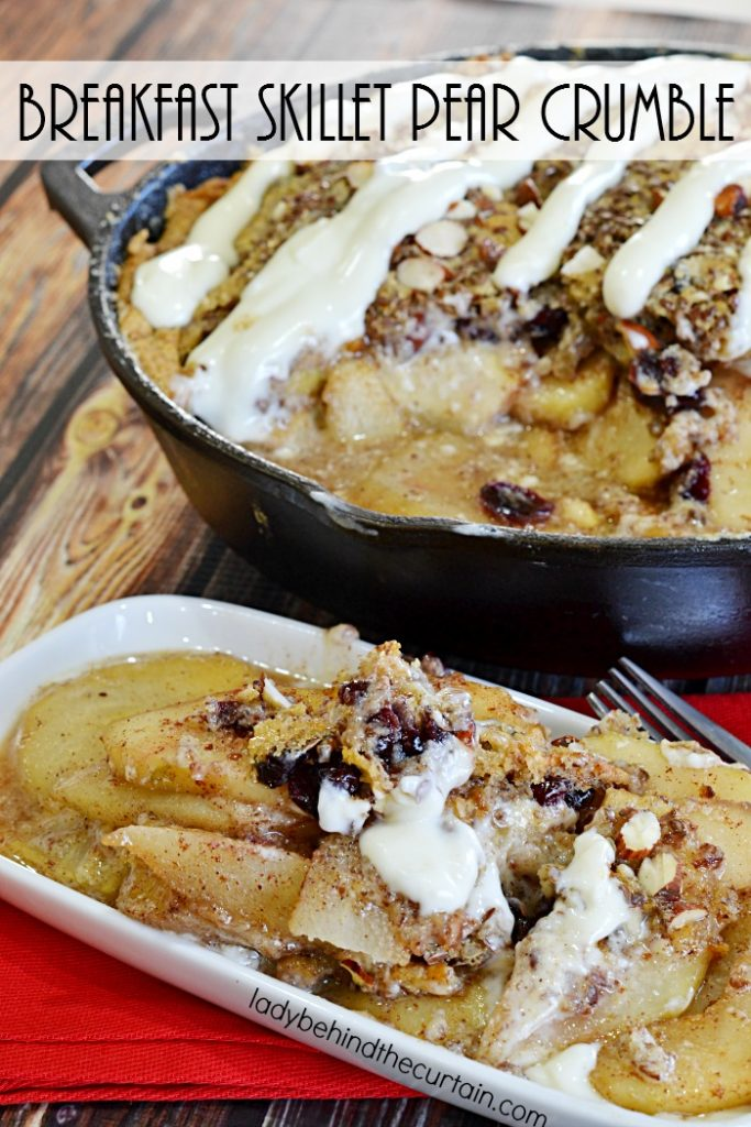 Breakfast Skillet Pear Crumble | This crumble is loaded with tons of pears, a few cranberries, a light crumble and a creamy cheesecake glaze. Perfect for Thanksgiving or Christmas!