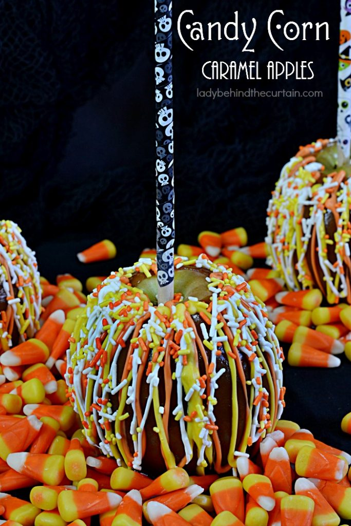 Candy Corn Caramel Apples | Your favorite apple dipped in easy to make caramel and drizzled with festive candy melts plus candy corn colored sprinkles! Perfect for your Halloween Party, Carnival or Fall Festival!
