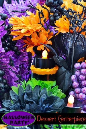 Halloween Party Dessert Centerpiece | This colorful centerpiece doubles as dessert! If you look closely you will see push up pops tucked in the arrangement. Perfect for Halloween!