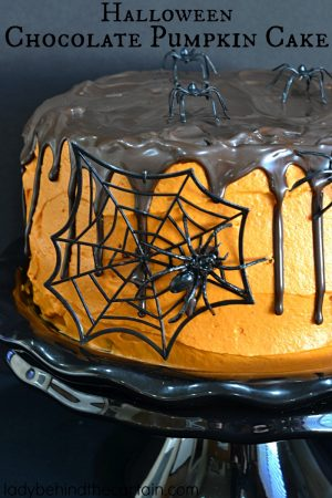 Halloween Chocolate Pumpkin Cake | This cake will be a hit at your Halloween party it not only delivers in flavor but also adds a touch of creepiness to your party table.